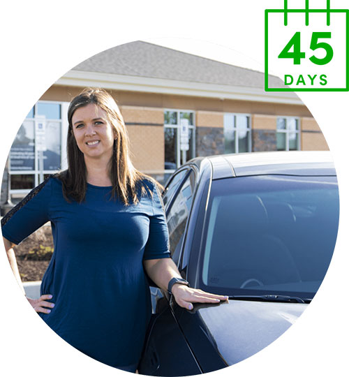 Woman Smiling Standing by Car